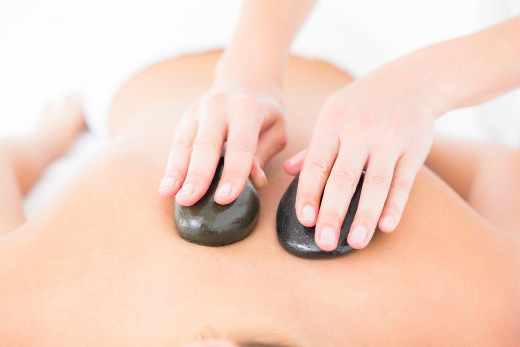 Hot Stone Massage Moondance Wellbeing Angelique Bavich Massage Therapy Reflexology Bunbury